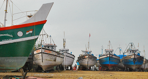 Docked fishing boats near the watch tower