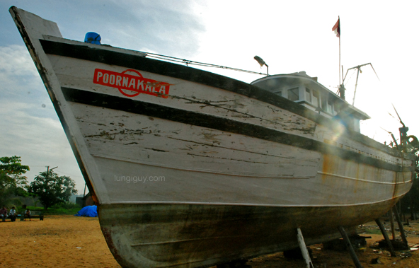 A docked fishing boat near the watch tower