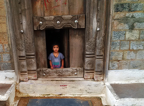 A child at the door of a queer Gadag house